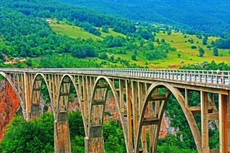 hill of tara: Bridge Djurdjevica in Montenegro over the Tara Canyon hdr Stock Photo
