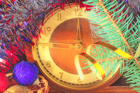 12 oclock: New year clock, Christmas decorations and fir branch