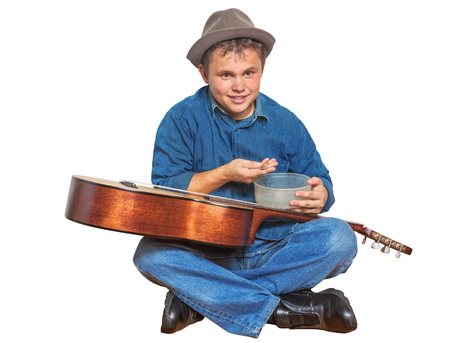 Young busker counts earned money and smiling isolated photo