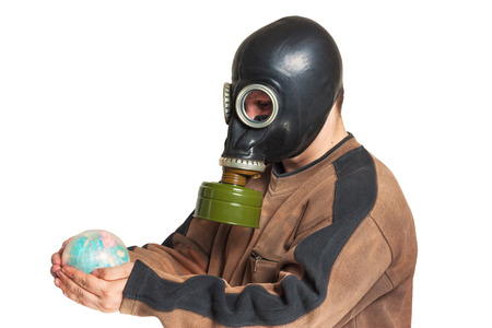 Young man in a gas mask holding a globe isolated photo