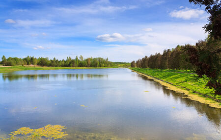 horisontal: Beautiful lake, forest on background and blue sky landscape horisontal Stock Photo