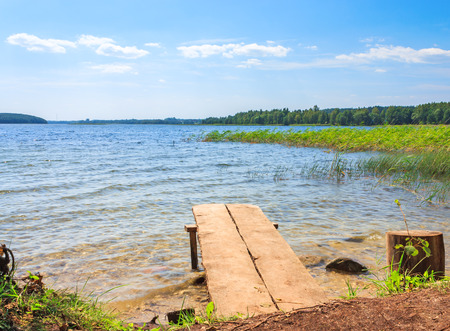 braslav: Beautiful clear lake with a wooden pier in the Braslav Lakes
