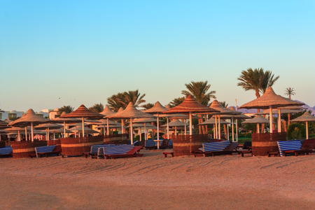 sharm: Parasols and sunbeds on the Red Sea in Sharm el-Sheikh Stock Photo