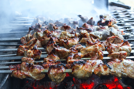 Appetizing shashlik with onions cooked on the grill photo