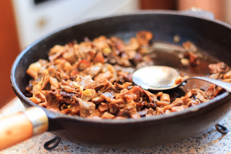 skillet: Delicious fried mushrooms in a skillet closeup Stock Photo