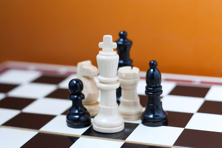 Group of chess pieces on a chess board photo