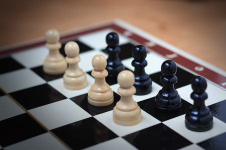 confrontation: Confrontation of pawns on a chess board concept