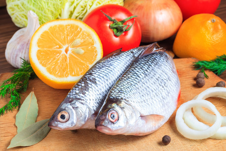 Fresh fish with vegetables and spices. Cooking fish