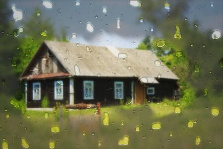 Cottage with blur effect and raindrops in the country