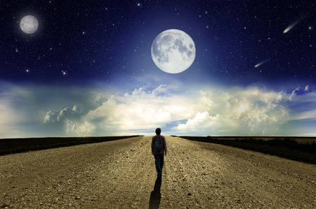 straight man: Man walking on the road at night in the moonlight