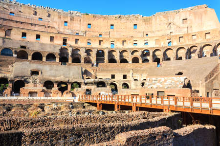 Roman colosseum in italy inside view daytime photo