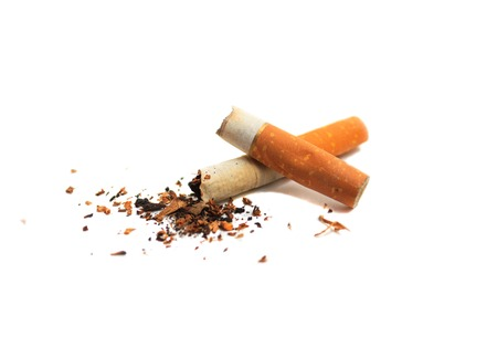 Cigarette butts on a white background isolated. Give up smoking photo