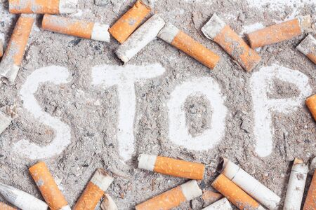 Cigarette butts and ashes. Quit smoking now Stock Photo
