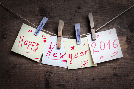 clothespins: Happy New Year 2016 card with clothespins on wooden surface