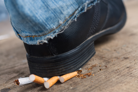 crush on: Man quit smoking and crush cigarettes foot