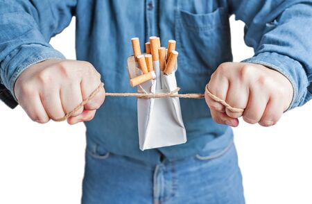 anti smoking: Quit smoking, human hands breaking the pack of cigarettes isolated