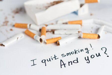 anti tobacco: Antismoking background with broken cigarettes. Quit smoking now Stock Photo