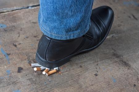 anti tobacco: Man quit smoking and crush his cigarettes