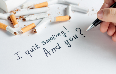 Antismoking background with a heap of broken cigarettes. Quit smoking now Stock Photo