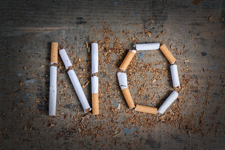 anti smoking: No word of a cigarette on a wooden surface. Antismoking background