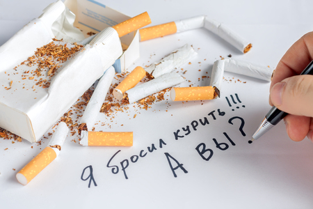 anti tobacco: Antismoking background with a heap of broken cigarettes. Stop smoking now