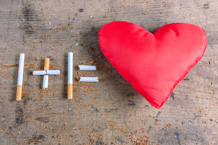 diseased: Antismoking background. Cigarettes and diseased heart. Quit smoking now