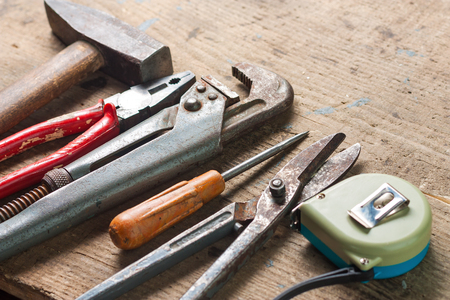 repairs: Set of tools for repairs on a wooden surface
