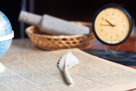Retro still life with pen and clock on a wooden table Stock Photo