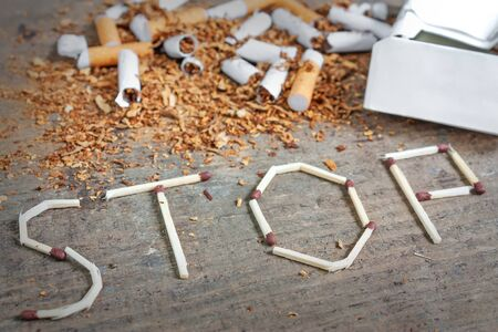 Broken cigarettes and tobacco and matches. Quit smoking now