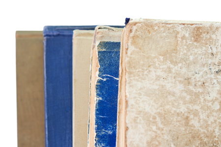 Stack of worn books isolated on white background Stock Photo