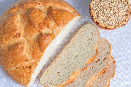 Sliced white bread and grains of wheat. Top view Stock Photo