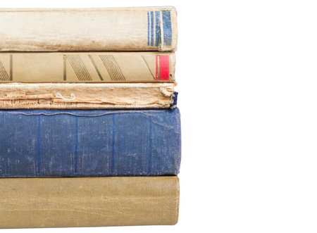 Stack of old worn books isolated on white background