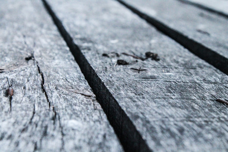 Background of wooden old and rotten boards Фото со стока