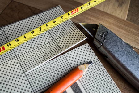Linoleum. Samples of flooring with wood texture. Cutting in size. New Year.