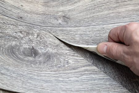 Roll of linoleum with a wood texture. Linoleum cutting. Floor coverings.