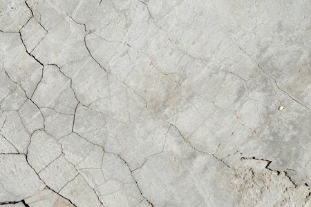 Cracked concrete texture. Faults and cracks on the stone surface.