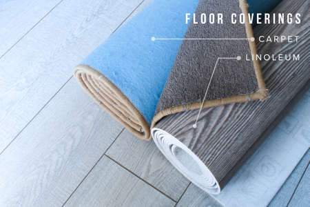 Carpet and linoleum are rolled up and lie on the laminate floor Archivio Fotografico
