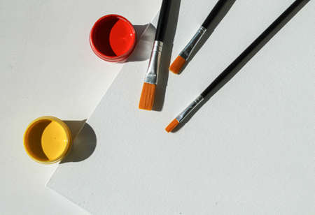 Acrylic paints, brushes and painting canvas. shot from above