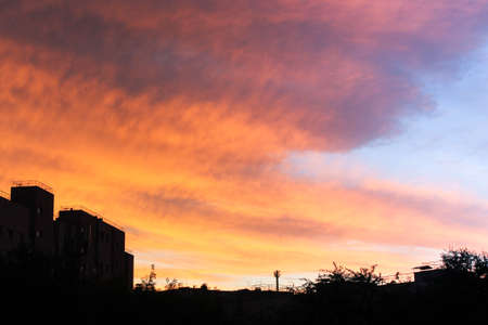 The sunset is bright orange. The sky at sunset. Archivio Fotografico