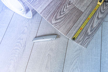 Linoleum roll with wood texture, shot from above