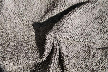 Gray microfiber napkin. Gray cloth for the kitchen. Close-up. Archivio Fotografico