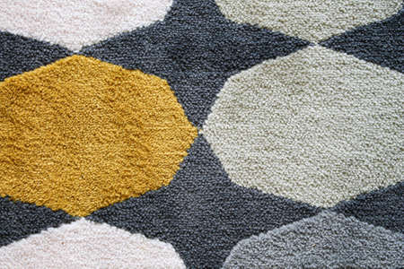 Multi-colored carpet with geometric shapes. Close-up. Archivio Fotografico