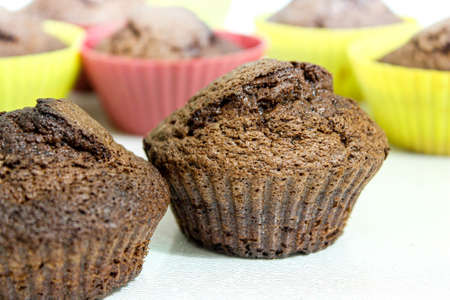 Baked muffins on a white table.Close -up Archivio Fotografico