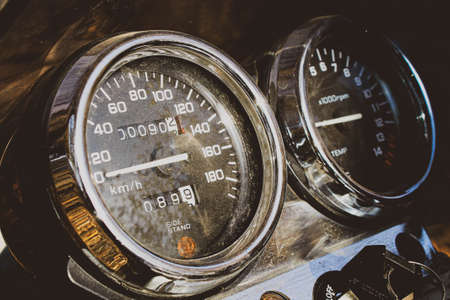 Motorcycle instrument panel. Speedometer and tachometer close-up.