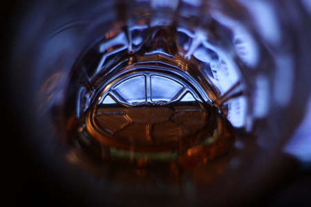 skoal: Light in the end of a tunnel (a bottom of a beer mug with beer) the world eyes of the alcoholic Stock Photo