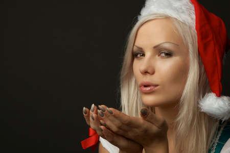 sexy young girl: Портрет красивая сексуальная женщина носить одежду Рождество на черном фоне Фото со стока