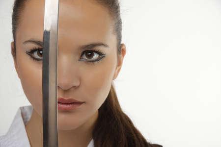samurai sword: Attractive young sexy women with samurai sword on white background