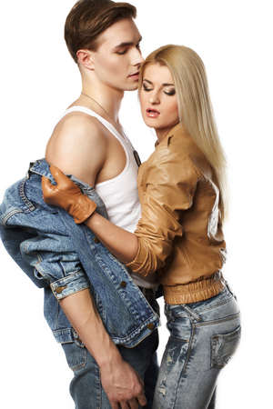 jeanswear: Sexy young couple wearing jeans in the studio