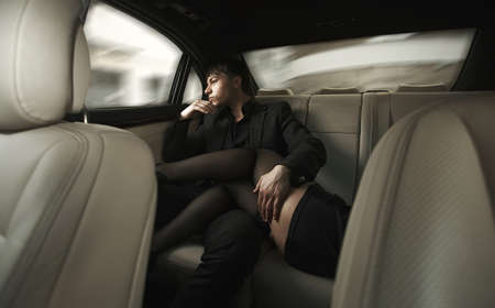 Adult sexy man sitting in car with girl