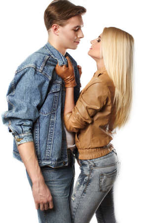 sexy young girl: Sexy young couple wearing jeans in the studio